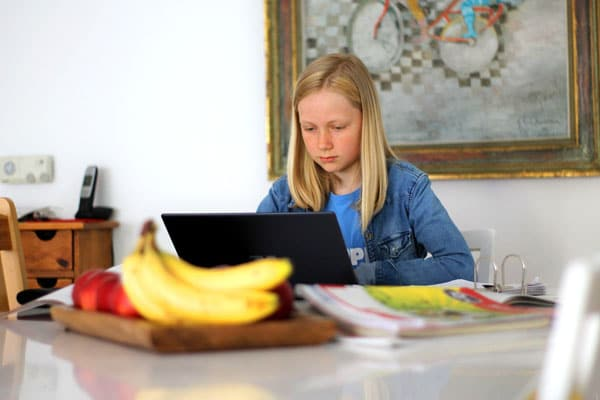 Homeschooling girl learning at table