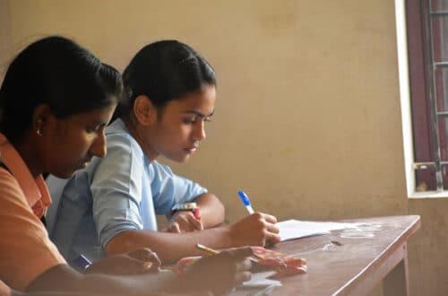 Student girl-teen in exam class room