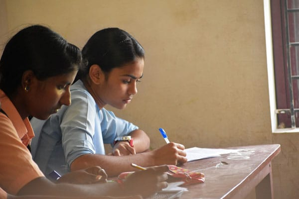 Student girl-teen in exam class room